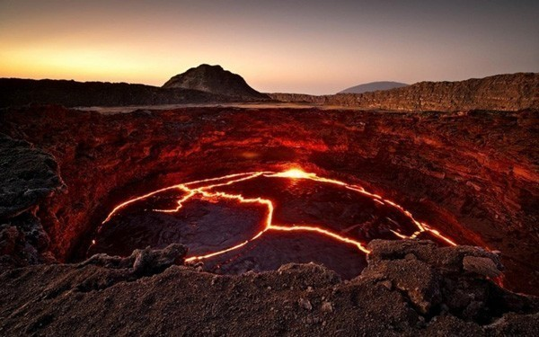 -High impact contrast in the photograph portraying a lake of lava in the crater of Volcano Erta Ale in Ethiopia.
