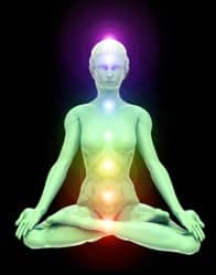 3D illustration of woman meditating and energizing her energy centers (chakras) through the lotus position