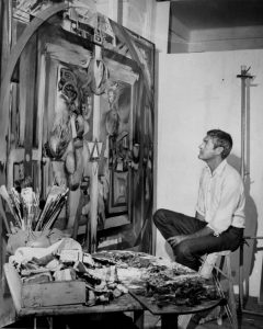 Timothy Leary studies a painting done by another LSD user in a studio at a house in Millbrook, N.Y. (Hal Mathewson/New York Daily News Archive via Getty Images)