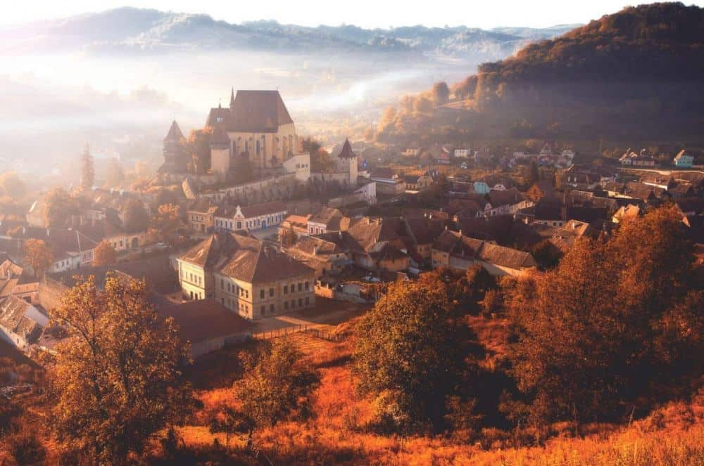 © nicu hoandra Morning fog over the village of Biertan.