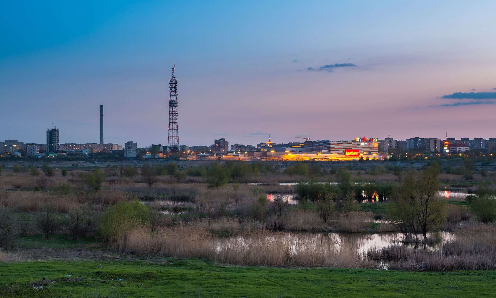 Nightfall over the south-eastern Bucharest suburbs near Văcărești Lake. Photograph: Alamy