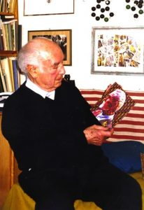 Albert Hofmann holding a Timothy Leary Blotter Art Sheet (via Blotter Barn)