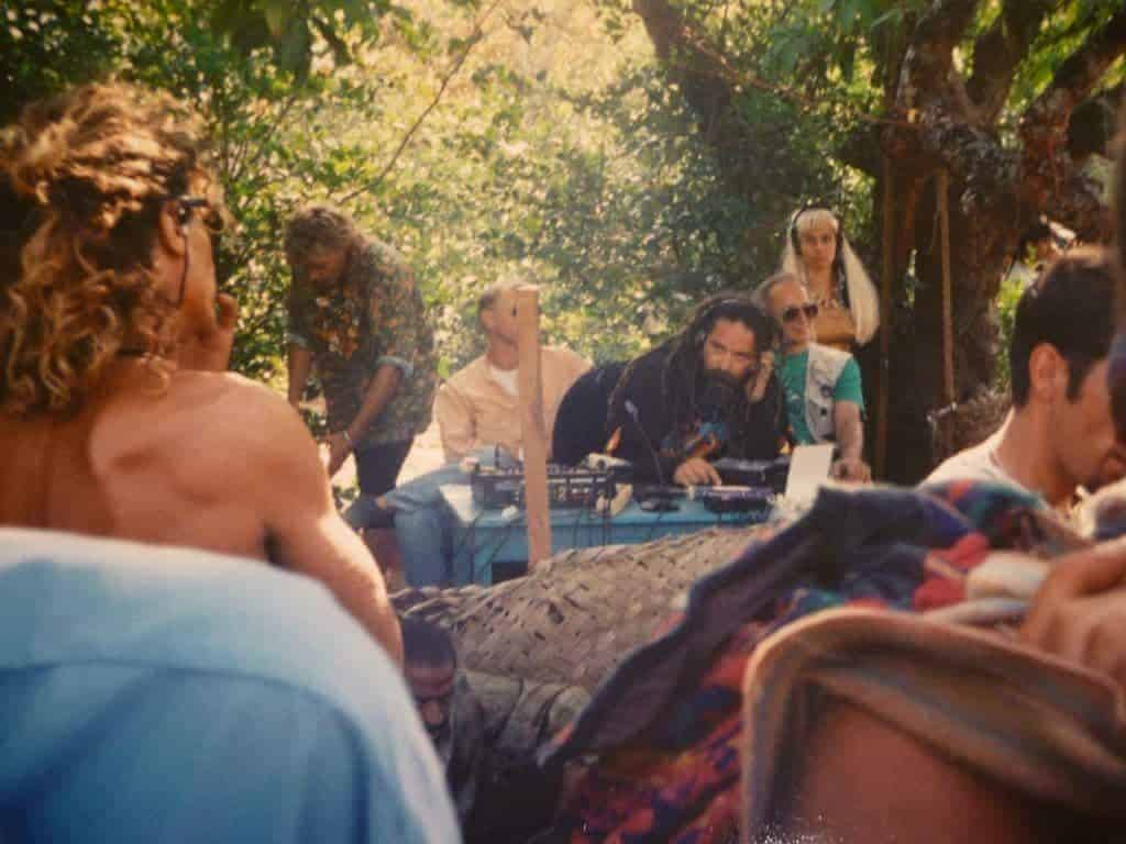 Anjuna, Goa, 1993. DJing Goa Gil, on the left standing by the DJ table, Chicago (1200 Micrograms). (Photo by Lukas Rydholm).