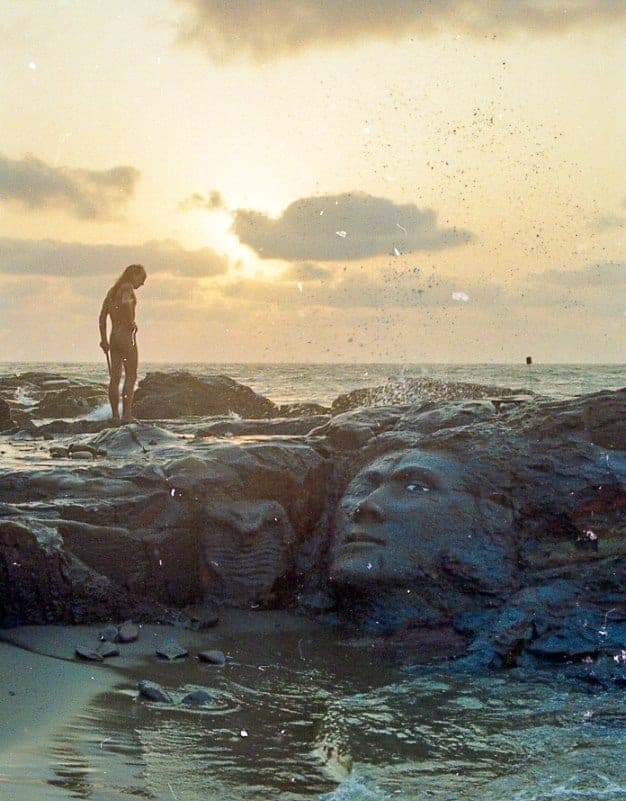Jungle and his famous Shiva face carving on the rocks of Little Vagator in the early 90s. The sculpture, though heavily eroded by the waves, is still there. (Photo by John Tizi).