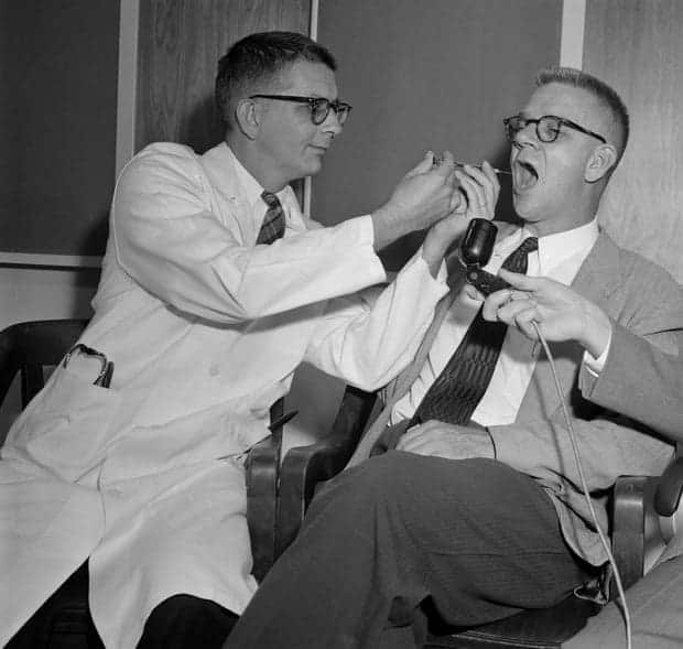 dr-harry-l-williams-left-administers-lsd-to-dr-carl-pfeiffer-chairman-of-emory-universitys-pharmacological-department-in-1955