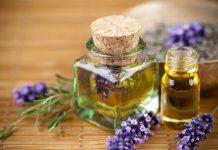 Bottle of lavender oil on table.
