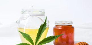 Marijuana leaf and sweet honey in a jar
