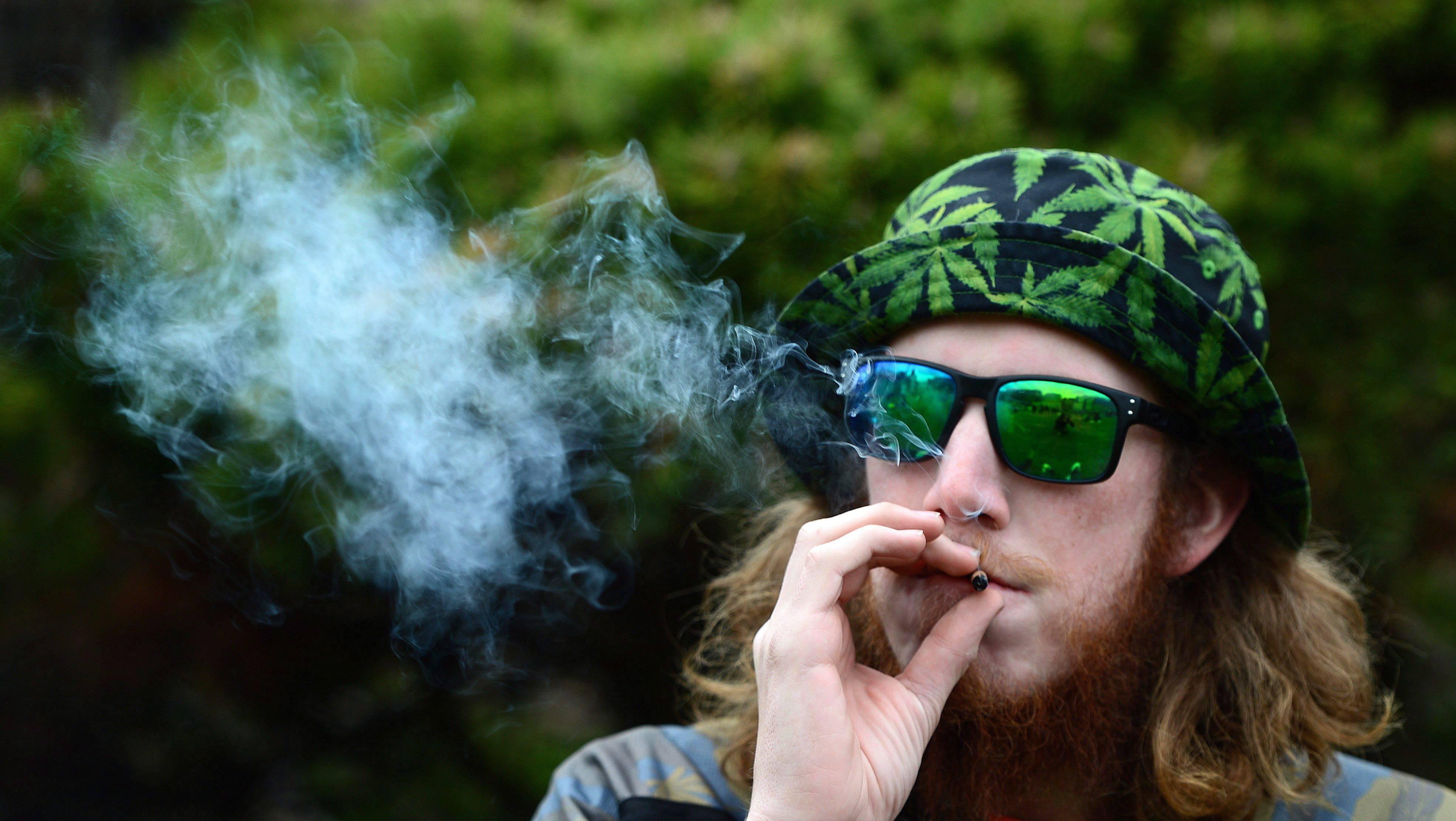 a man smoking weed